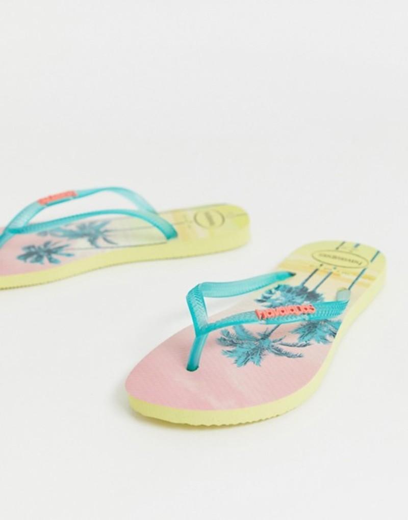 ハワイアナス レディース サンダル シューズ Havaianas slim flip flops in tropical palm print Pollen yellow