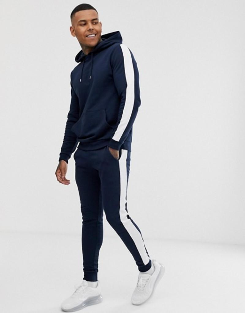 エイソス メンズ カジュアルパンツ ボトムス ASOS DESIGN tracksuit with hoodie and side stripe in navy Navy