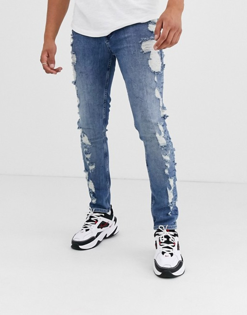 エイソス メンズ デニムパンツ ボトムス ASOS DESIGN skinny jeans in mid wash blue with extreme rips Mid wash blue