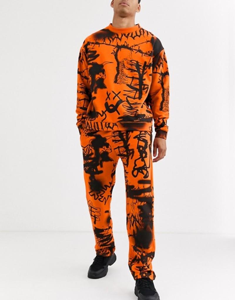 ジェーデッド メンズ カジュアルパンツ ボトムス Jaded London sweatpants in orange graffiti print Orange