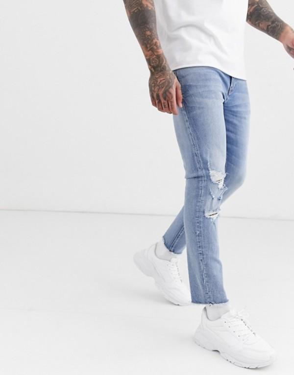 エイソス メンズ デニムパンツ ボトムス ASOS DESIGN cropped skinny jeans in light wash with raw hem and busted knee Light wash blue