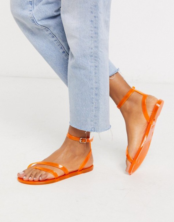 エイソス レディース サンダル シューズ ASOS DESIGN Fluke asymetric jelly flat sandals in neon orange Neon orange