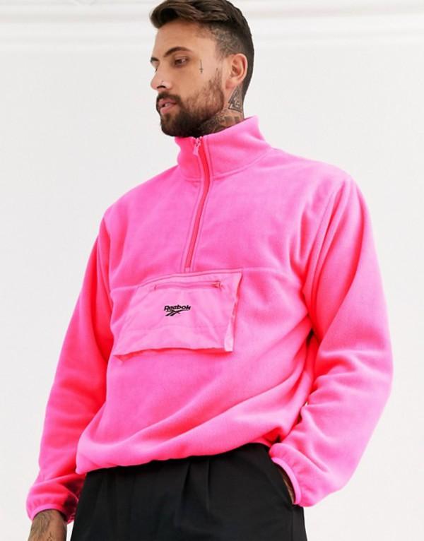 リーボック メンズ ジャケット・ブルゾン アウター Reebok trail fleece jacket in pink Pink