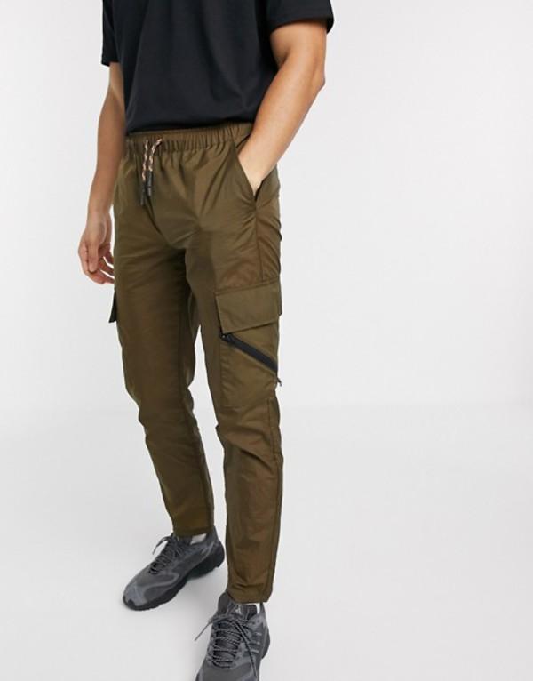 エイソス メンズ カジュアルパンツ ボトムス ASOS DESIGN slim pants in nylon with contrast trims Green