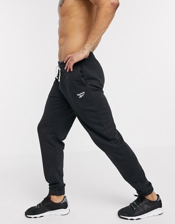 リーボック メンズ カジュアルパンツ ボトムス Reebok Training cuffed sweatpants in black Black