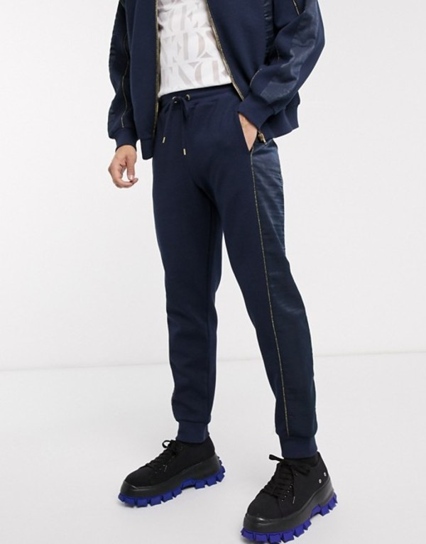 エイソス メンズ カジュアルパンツ ボトムス ASOS EDITION two-piece tapered sweatpants with satin panels in navy Navy