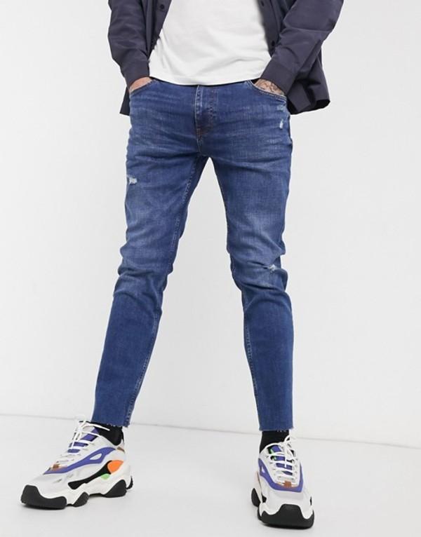 ベルシュカ メンズ デニムパンツ ボトムス Bershka skinny jeans with abrasions in mid blue Blue