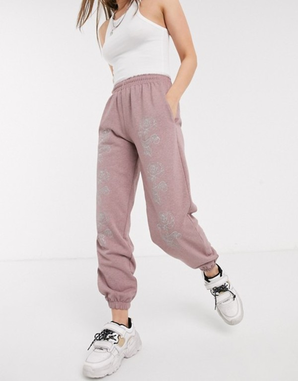 ニューガールオーダー レディース カジュアルパンツ ボトムス New Girl Order relaxed sweatpants with glitter roses in washed pink Pink