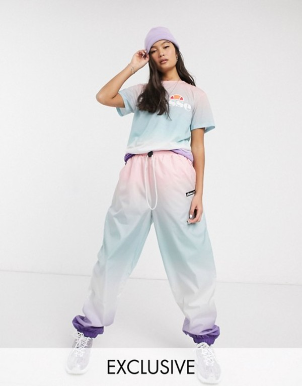 エレッセ レディース カジュアルパンツ ボトムス Ellesse relaxed sweatpants in rainbow fade print two-piece Multi