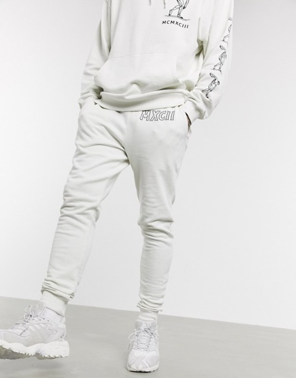 エイソス メンズ カジュアルパンツ ボトムス ASOS DESIGN two-piece skinny sweatpants in white with text detail Vaporous gray