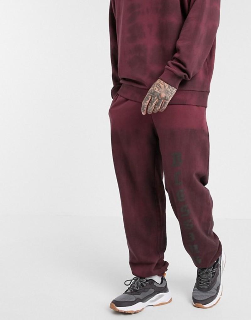 エイソス メンズ カジュアルパンツ ボトムス ASOS DESIGN two-piece oversized jogger with text print in washed burgundy Burgundy