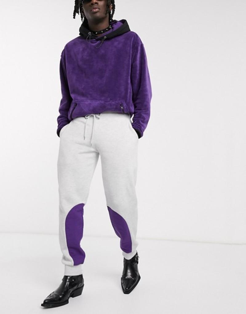 エイソス メンズ カジュアルパンツ ボトムス ASOS DESIGN tapered sweatpants in white marl with purple nylon panels White marl