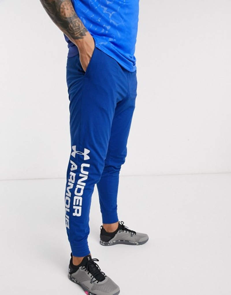 アンダーアーマー メンズ カジュアルパンツ ボトムス Under Armour Training cotton graphic logo sweatpants in blue Blue