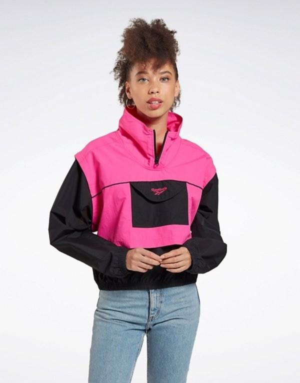 リーボック レディース ジャケット・ブルゾン アウター Reebok Vector cropped jacket in pink Pink