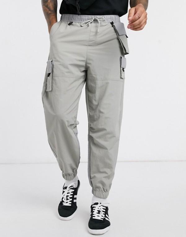 エイソス メンズ カジュアルパンツ ボトムス ASOS DESIGN oversized tapered sweatpants in gray with detachable pockets Gray