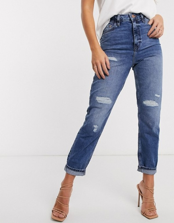 リバーアイランド レディース デニムパンツ ボトムス River Island Carrie ripped high rise mom jeans in mid auth blue Mid auth