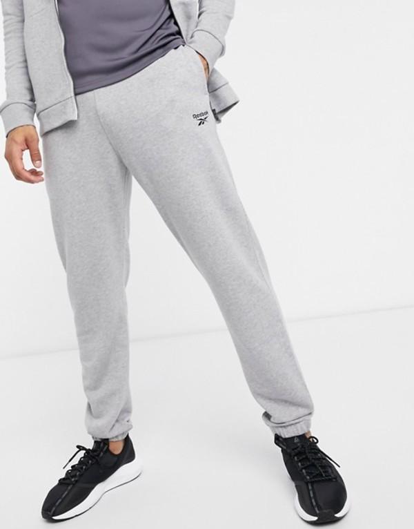 リーボック メンズ カジュアルパンツ ボトムス Reebok Training cuffed sweatpants in gray marl Gray