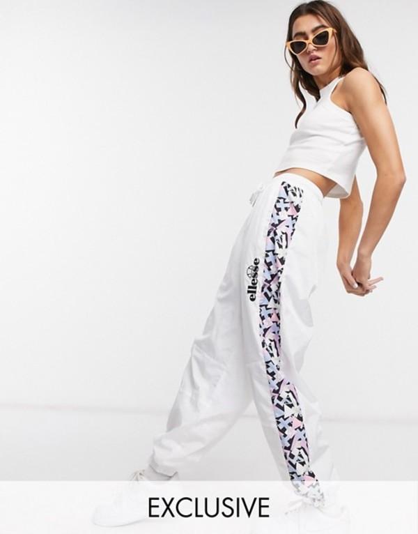 エレッセ レディース カジュアルパンツ ボトムス Ellesse oversized woven sweatpants with vintage print side panels two-piece White