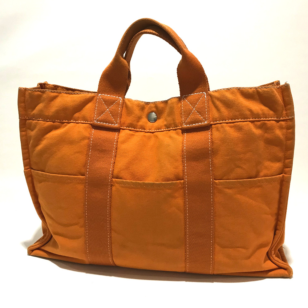 BRANDSHOP REFERENCE  AUTHENTIC HERMES Hawaii only Fourre ToutMM Men s Women s  Tote Bag Orange Canvas  62c52d4587
