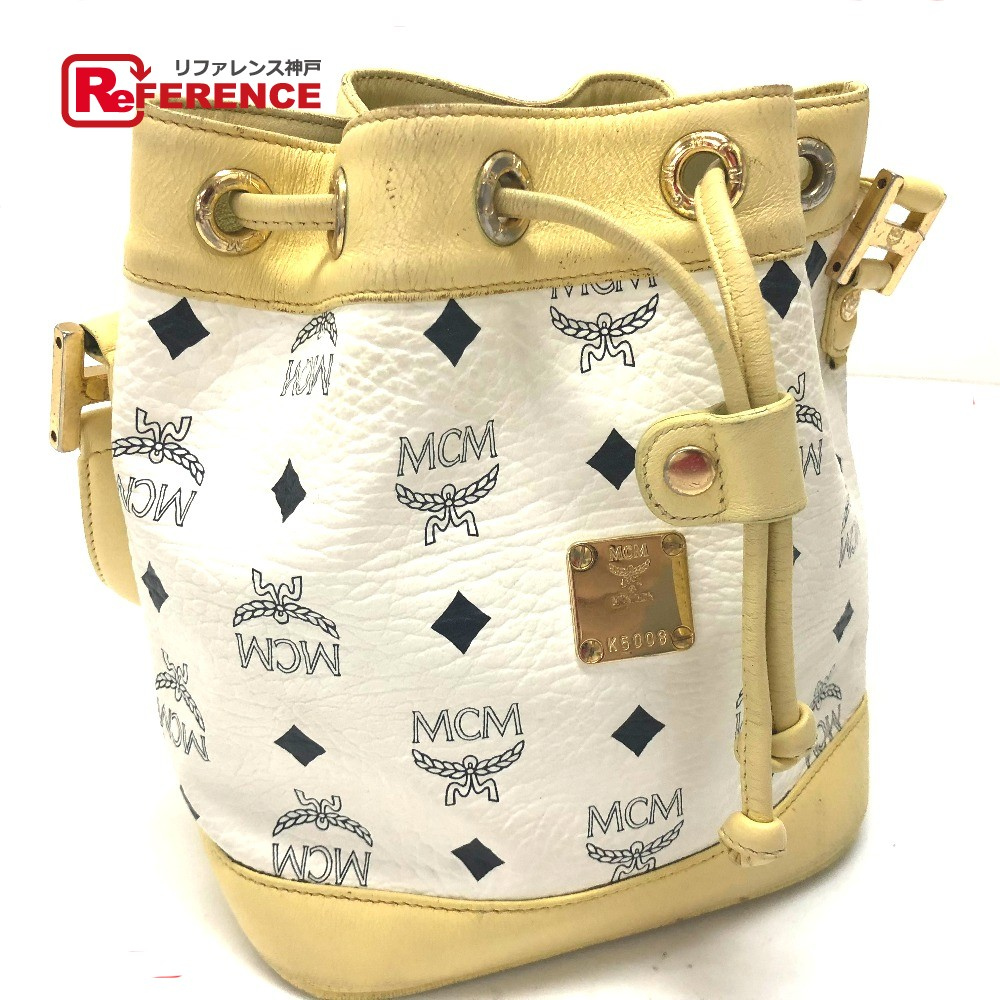 70d236def1 AUTHENTIC MCM Logo Plate logo studs Shoulder Bag Drawstring bag Hand Bag  White yellow Leather ...