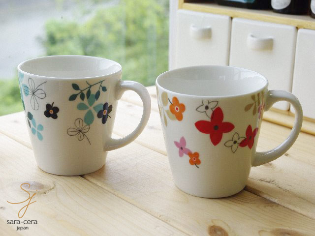 the pair set of the mug cup which is pop it is a gift treasure with a colorful hue of the table accentuate it is the set which is most suitable for