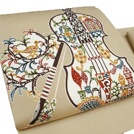名古屋帯 九寸帯 栗山吉三郎工房 和染紅型 バイオリン 正絹 浜ちりめん 仕立て上がり カジュアル 染帯 ベージュ d545