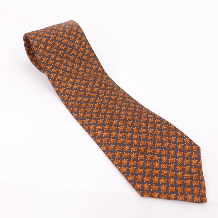 【中古】 HERMES ネクタイ オレンジ系 タートル柄 シルク100%