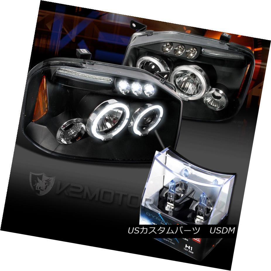 ヘッドライト For 01-04 Frontier Black LED Halo Projector Headlights+H1 Halogen Bulbs 01-04フロンティアブラックLEDハロープロジェクターヘッドライト+ H1ハロゲン電球