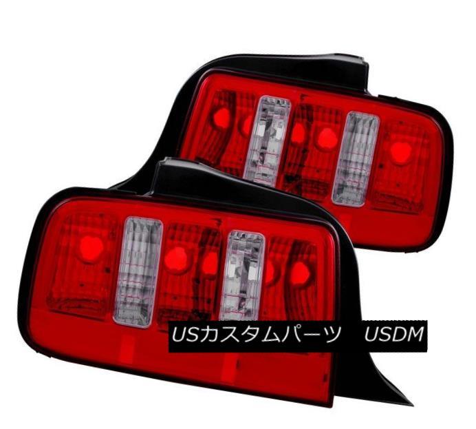 テールライト ANZO 221166 Set of 2 Red/Clear Lens Tail Lights for 2005-2009 Ford Mustang ANZO 221166 2005年?2009年のフォードマスタング用の2つのレッド/クリアレンズテールライトのセット