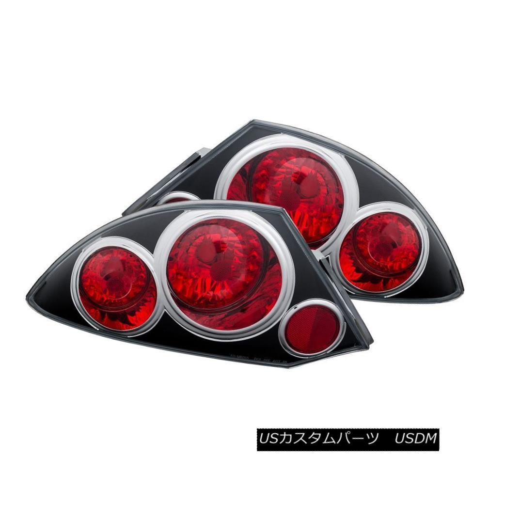 テールライト ANZO 221081 Black Halogen Tail Lights for 00-02 Mitsubishi Eclipse (Set of 2) ANZO 221081 00-02 Mitsubishi Eclipse(2セット)用ブラックハロゲンテールライト