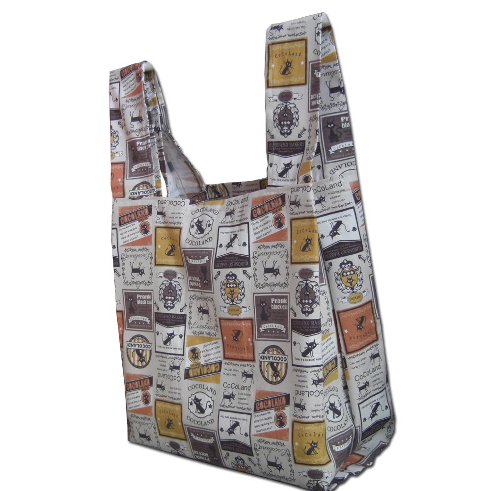 公式 ユニークなクロネコCoCoワッペン柄の綿100%生地を使った折り畳めるエコトートバッグです 折りたためるクロネコCOCO缶ワッペン柄オレンジ.エコトートバッグ.オックス生地.綿100% 新生活