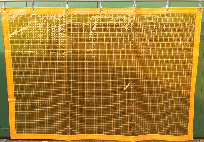 糸入りオレンジ透明 防虫・帯電・防炎 ビニールカーテン