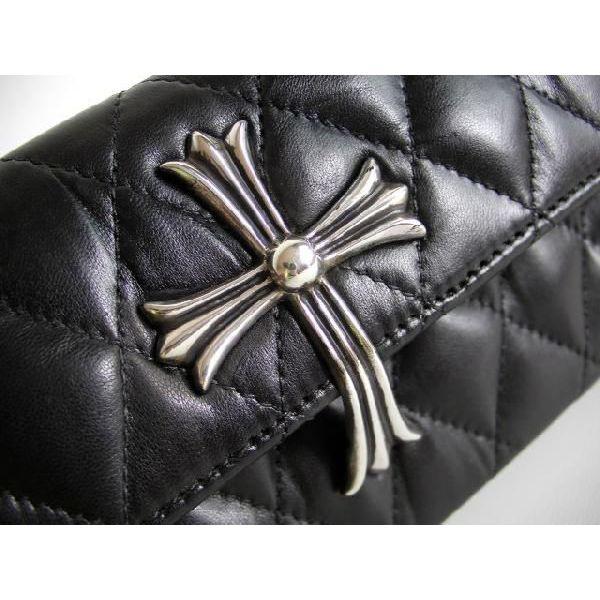 Chrome cross silver clutch bag