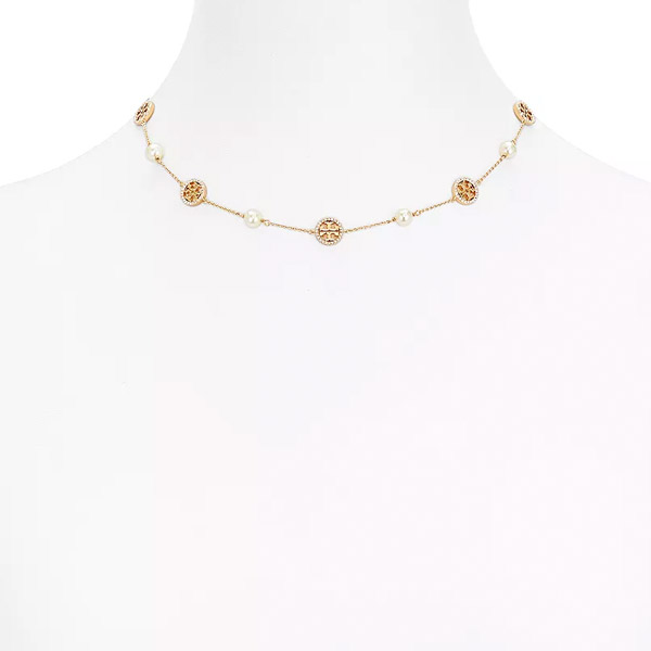 07d0a6e38de2a1 The item that the combination of logo design and imitation pearl is  stylish! It is recommended in a gift and a present. ◇TORY BURCH ...